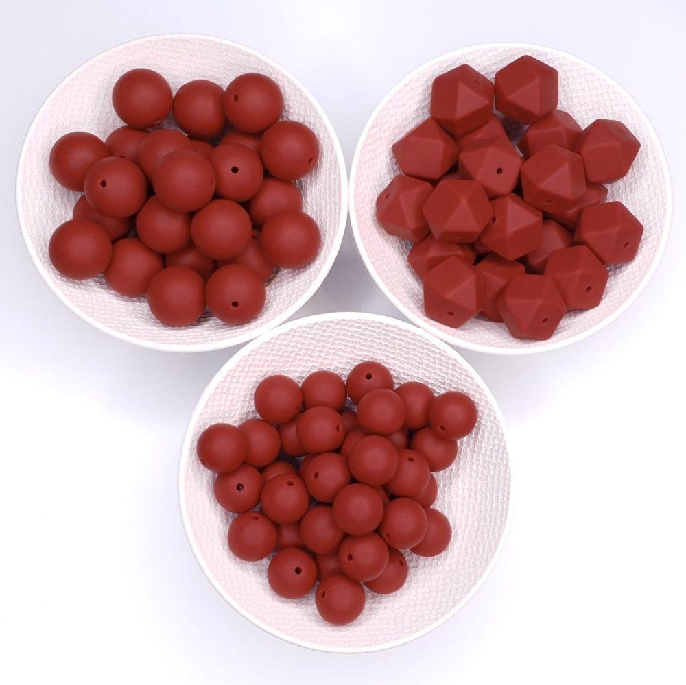 Siliconen kralen roest rood overzicht bijtspeelgoed