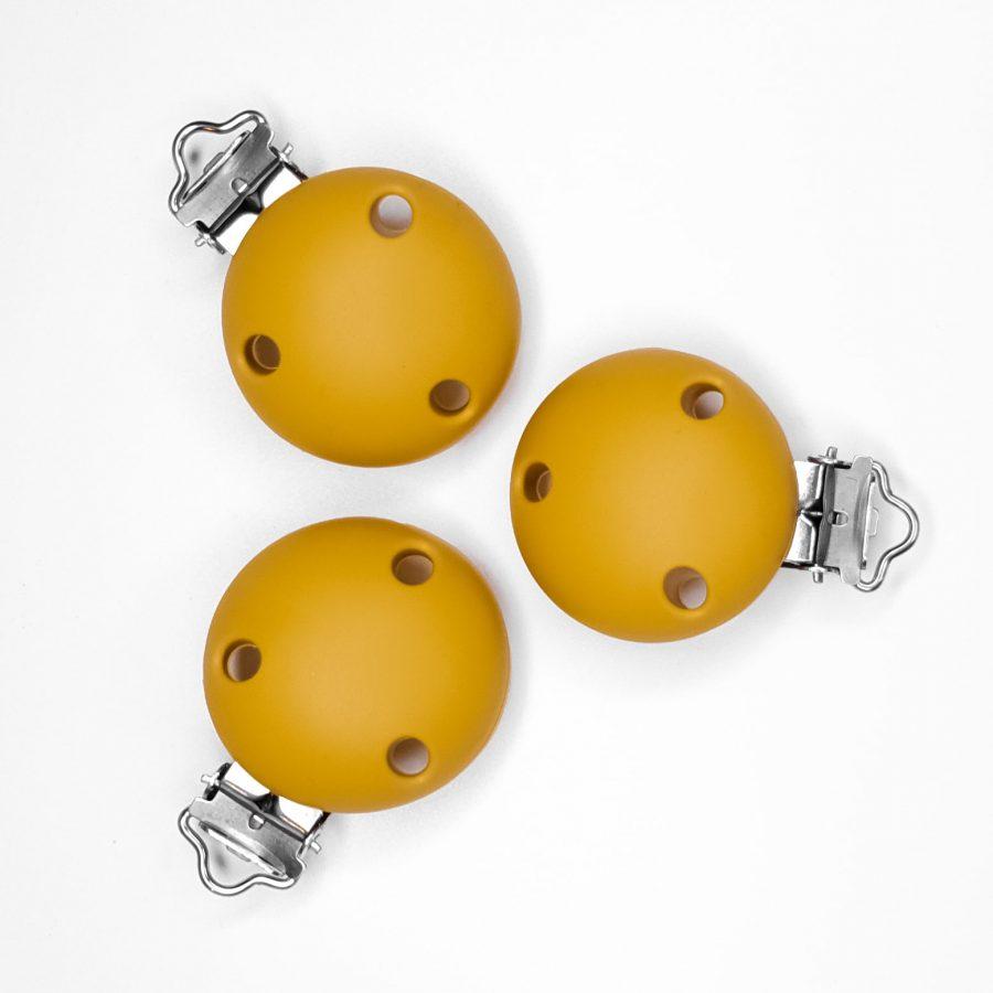 Siliconen speenclip met gaatjes baby veilig bpa vrij oker geel